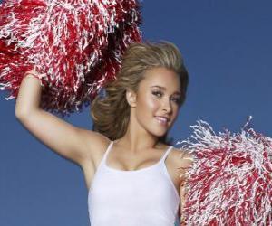 Puzle A cheerleader ou a torcida com pompons durante o show