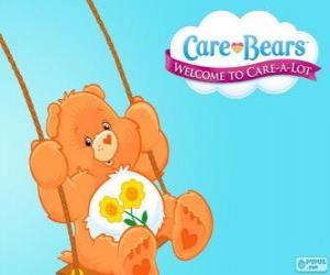 Puzle Amizade, o ursinho carinhoso que tem duas flores sobre a barriga