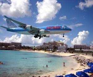 Puzle Aterragem de avião passando por cima da praia