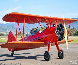 Puzle Avião biplano vermelho