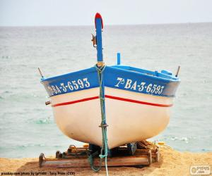 Puzle Barco que encalhado na praia