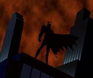 Puzle Batman, o homem-morcego, vigilando a cidade desde o telhado de um edifício em Gotham City