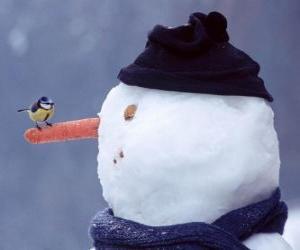 Puzle Boneco de neve com um pássaro em seu nariz