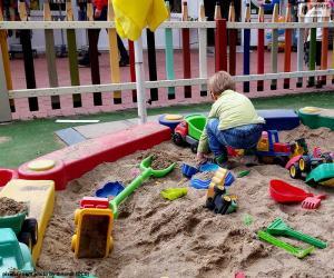 Puzle Criança na caixa de areia