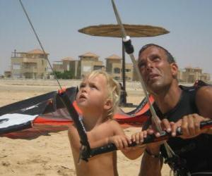 Puzle Criança fazendo empinando uma pipa com o pai