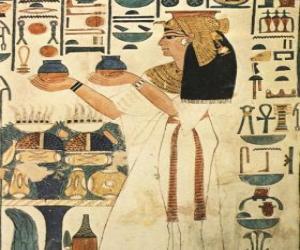 Puzle Gravado egípcio sobre pedra com a representação de uma deusa com inscrições ou hieróglifos