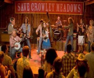 Puzle Hannah Montana (Miley Cyrus) realizando uma de suas canções em Crowley Corners, a cidade que deu origem a Miley.
