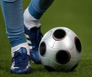 Puzle Jogador de futebol na condução da bola