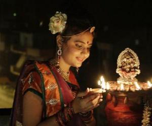 Puzle Mulher ajoelhada com uma lâmpada de azeite na mão na festa de Diwali