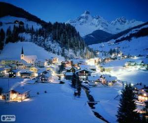 Puzle Pequena cidade completamente nevada na véspera de Natal