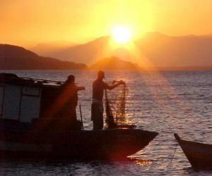 Puzle Pescadores ao pôr do sol