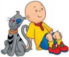 Caillou sentado no chão com seu gato Gilbert