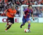 Jogador de futebol (Bojan Krkic F.C.B) na condução da bola