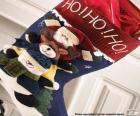 Meia do Natal com adornos e presentes