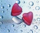 Dois corações vermelhos e pingos de chuva