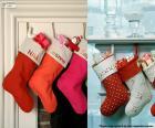 Vários pendurado meias de Natal cheia de presentes