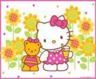 Hello Kitty com uma bebida no campo com seu ursinho de pelúcia Tiny Chum