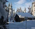 Cabana de madeira uma forte nevasca