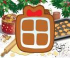 Biscoito com a forma de um presente de Natal