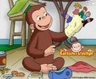 O curioso macaco George faz bonecos