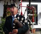 Jogador de gaita de fole, instrumento de vento