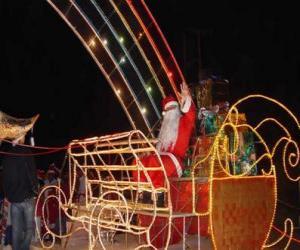 Puzle Santa Claus saudando com a mão do trenó mágico