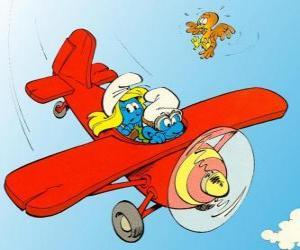 Puzle Smurf e Smurfette a pilotar um avião vermelho