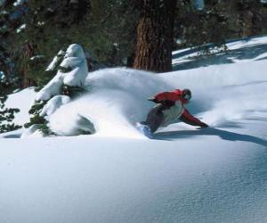Puzle Snowboarder descendente na neve fresca