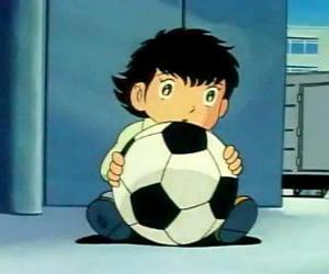 Puzle Tsubasa Ozora, Oliver Hutton, uma criança japonesa que é um grande adepto de futebol