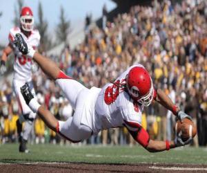 Puzle Um jogador, um wide receiver, lançadose para recolher um balão